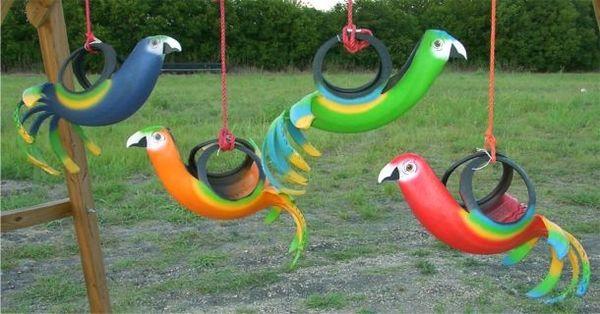 Яркие попугаи из старых шин