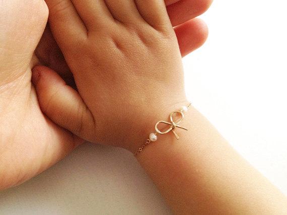 Золотой браслет с бантиком
