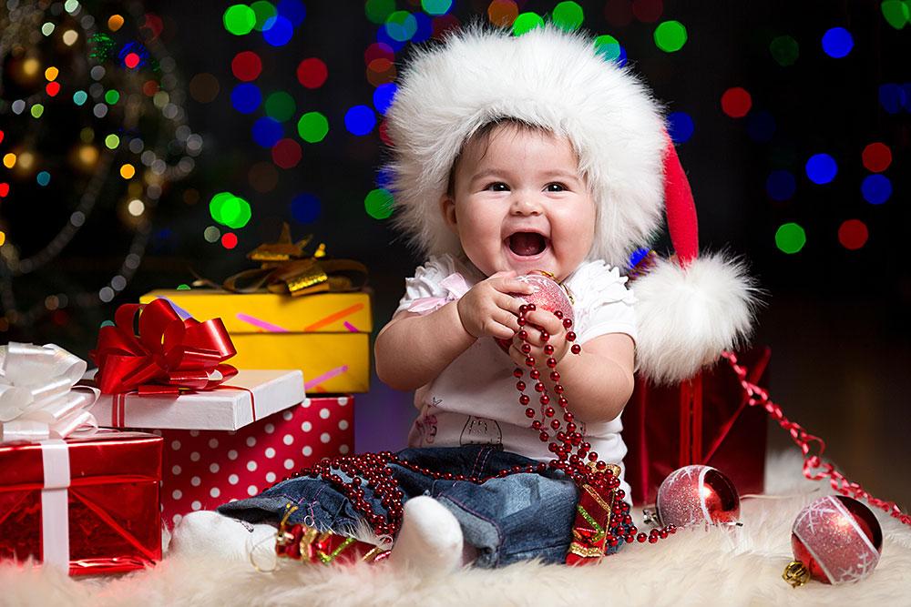 Что подарить ребенку до года