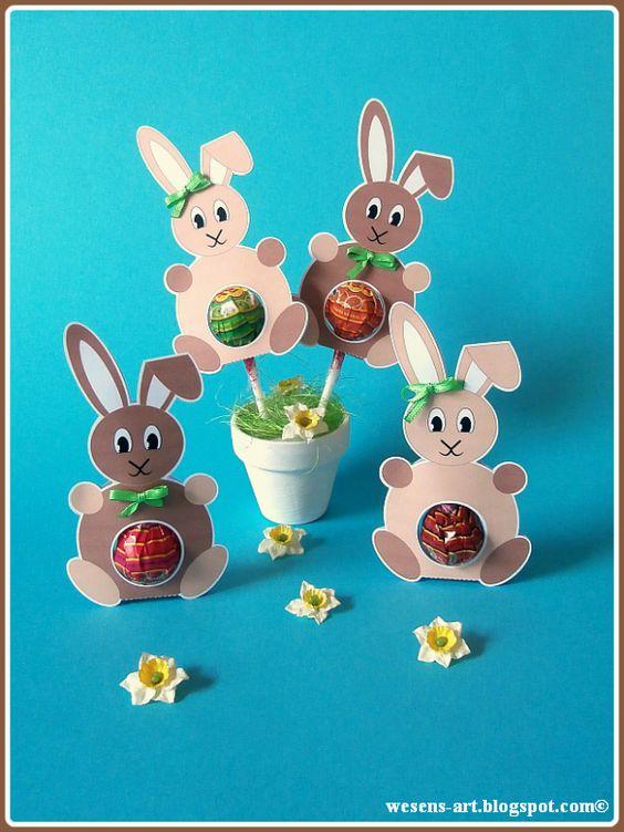 Кролики с конфетой на палочке
